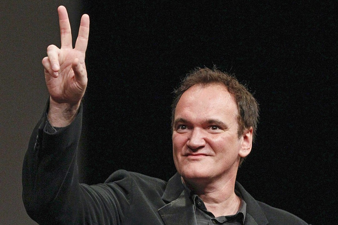 Quentin Tarantino gestures after receiving Prix Lumiere award during ceremony at 5th Festival Lumiere in Lyon