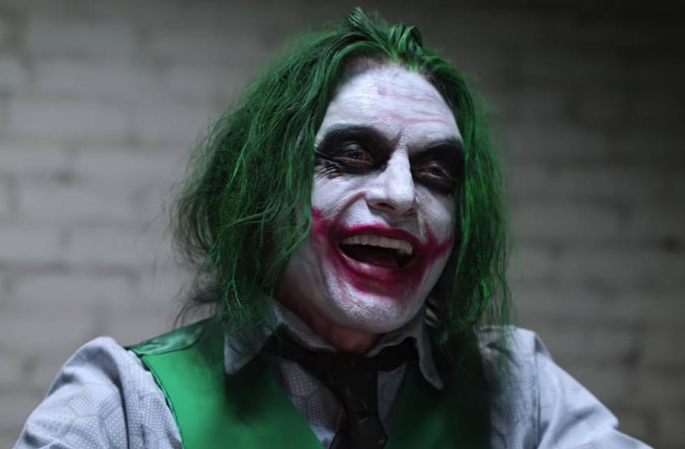 tommy wiseau still really wants to play the joker so he recreated a dark knight scene
